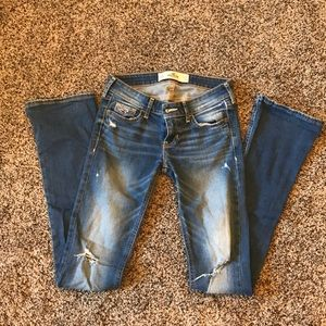 Hollister distressed low-rise boot cut jeans